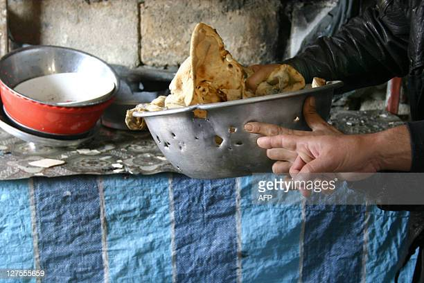 Iraqis display a bowl containing bread which was hit by gunfire in Ramadi 100km west of Baghdad in a shootout in which an Iraqi civilian died and six...