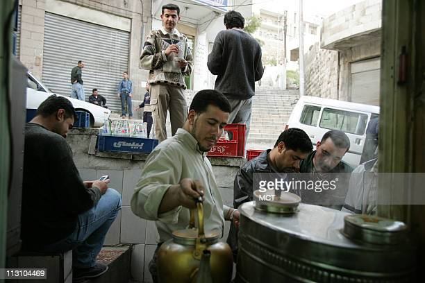 Iraqis drink tea outside of Baghdad Palace Restaurant in downtown Amman Jordan at a corner street which Iraqis call 'Sunni Triangle' because of the...