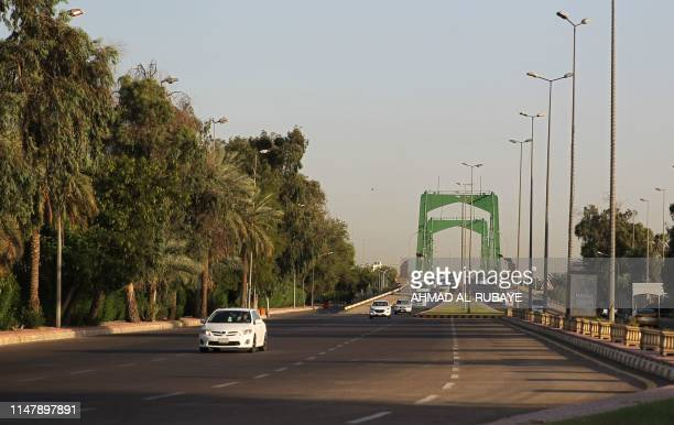 Iraqis drive in Baghdad's highsecurity Green Zone after all the main roads crisscrossing the enclave were opened on June 3 2019 The Green Zone home...