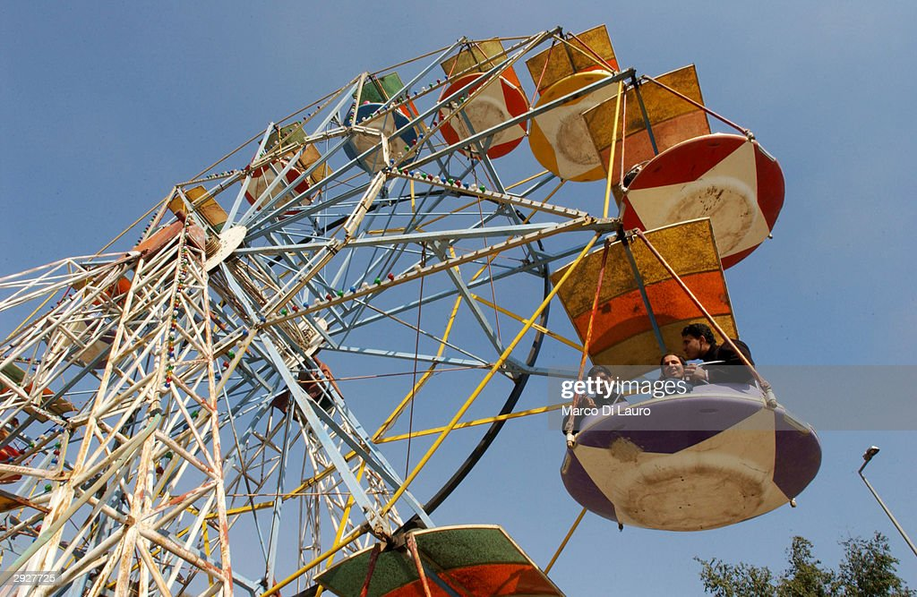 Iraqis enjoy their time at an amusement park in celebration