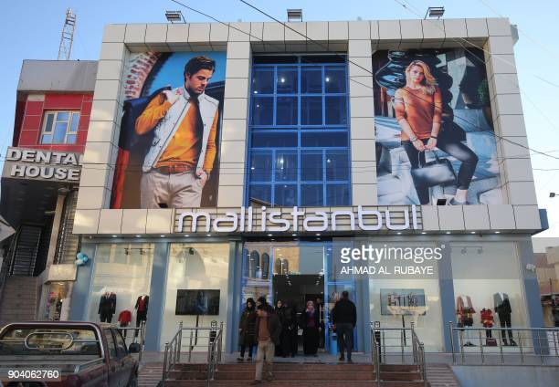 Iraqis enter a clothing store on the eastern bank of the Iraqi city of Mosul on January 9 six months after chasing out the jihadists whoo took...