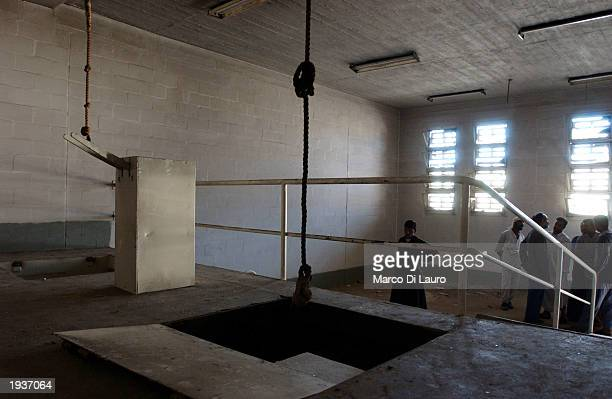 Iraqis examine the hanging gallows April 17 2003 inside the Abu Ghraib Prison 10 km west of Baghdad Iraq After years of rumors of atrocities said to...