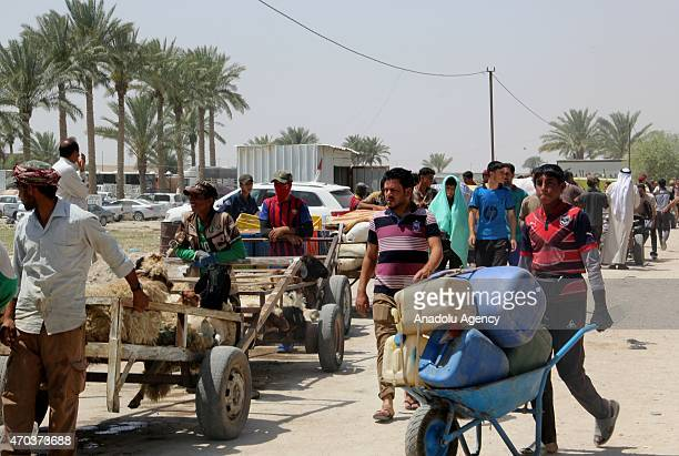 Iraqis fled the Iraqi city of Ramadi seized by Daesh militants carry their belongings with trailers and trolleys after they arrive in Baghdad Iraq on...
