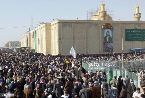 Iraqis gather around the Imam Ali Shrine in Najaf 160 kms south of Baghdad as they celebrate alGhadir Day 29 December 2007 Iraqi Shiites celebrated...
