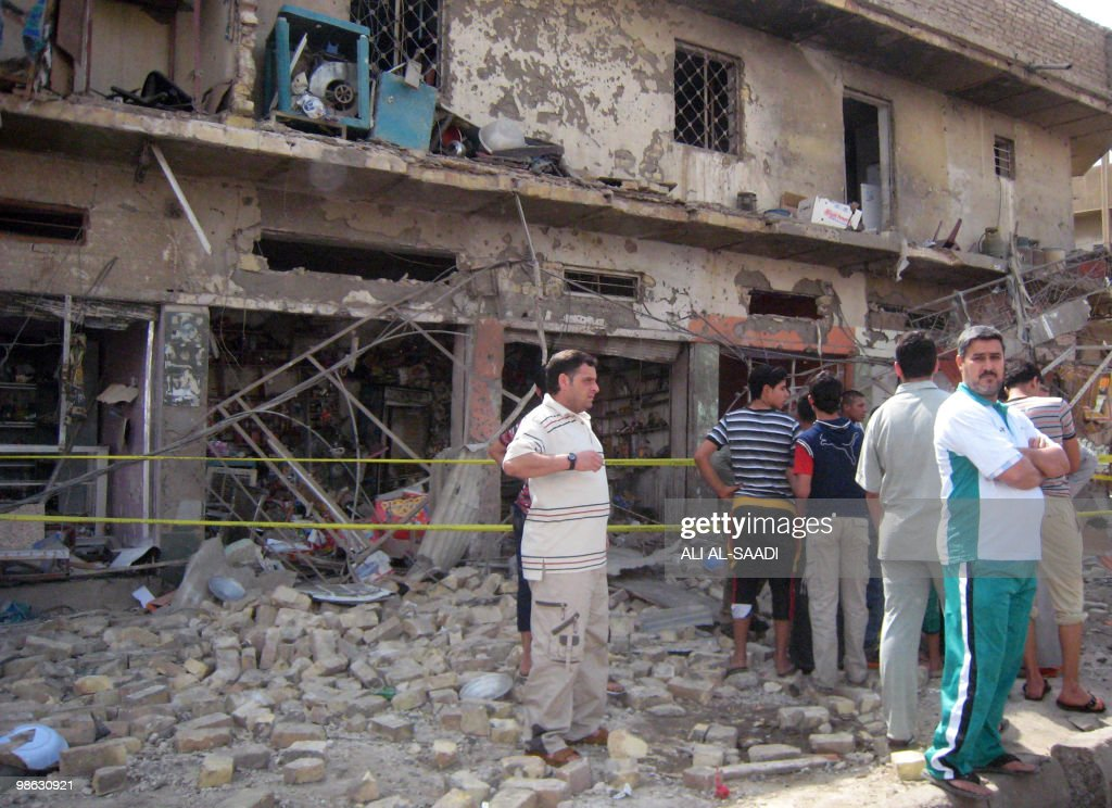 Iraqis gather at the scene of a car bomb explosion at the market of central Baghdad's Rahmaniya district on April 23, 2010. At least 50 people were killed in a series of car bombs near Shiite mosques in Baghdad, an interior ministry official told AFP.