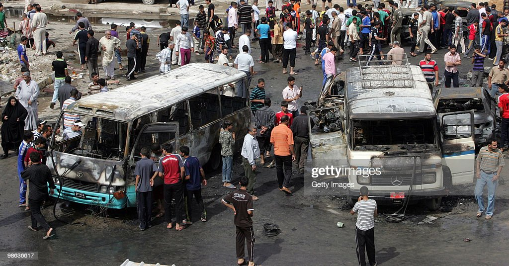 Iraqis gather at the scene of a car bomb explosion in Sadr city on April 23, 2010 in Baghdad, Iraq. A series of bombings rocked a market and Shiite mosques as worshippers departed Friday Prayer services, killing at least 60 people and wounding many more.