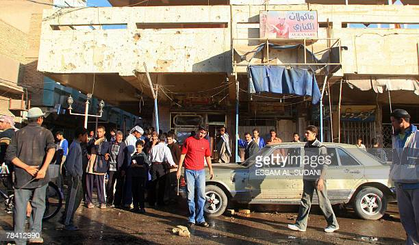 Iraqis gather at the site of a car bomb in the southern Shiite city of Amara 12 December 2007 At least 28 people were killed and 151 wounded in...