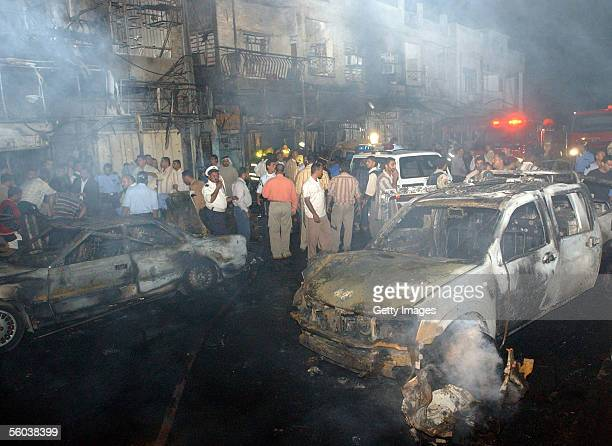 Iraqis gather at the site of car bomb explosion October 31, 2005 in Basra, Iraq. A car bomb exploded on a commercial street in the southern Iraqi...