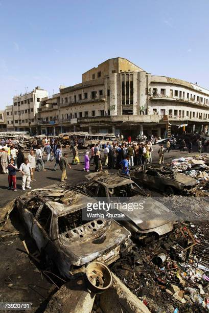 Iraqis gather at the site of the devastating Sadriya market bombing on April 19 2007 in Baghdad Iraq At least 127 people were killed and 148 wounded...