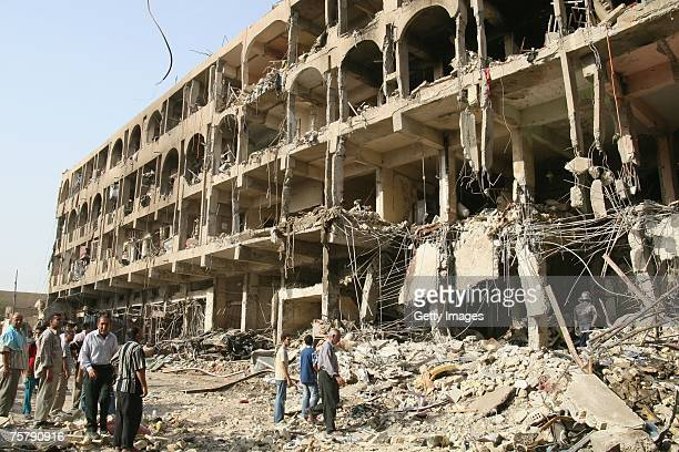 Iraqis gather at the site of yesterday's car bomb explosion which killed at least 25 and injured many more on July 27 2007 in the Shiite Karrada...