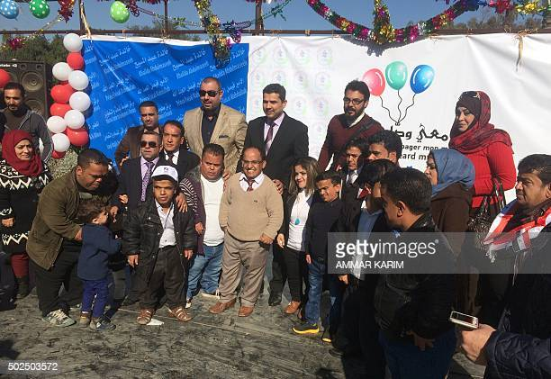 Iraqis gather during an event for people with dwarfism calling on the Iraqi government to better meet their needs and give them access to employment...