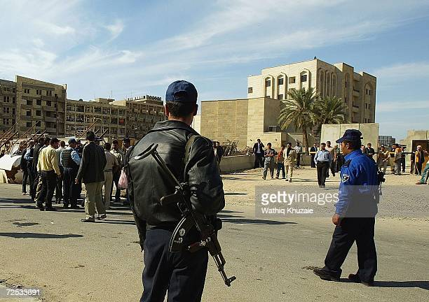 Iraqis gather for news of their relatives kidnapped from an Iraqi Higher Education building by gunmen on November 14 2006 in Baghdad Iraq At least...