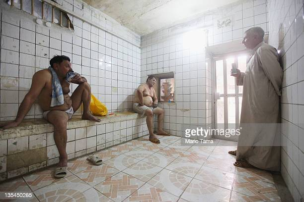 Iraqis gather in a hamam or Turkish bath on December 10 2011 in Baghdad Iraq Some Iraqis visit the baths because they do not have hot water at home...