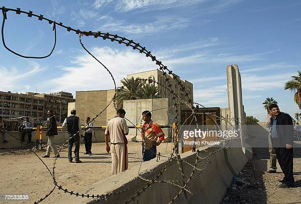 Iraqis gather in front of an Iraqi Higher Education building where some 100 government employees and visitors were kidnapped on November 14 2006 in...