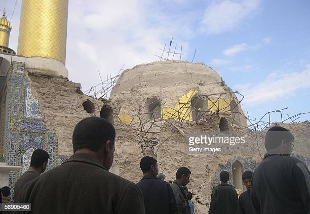 Iraqis gather inside the Shiite holy shrine of Ali alHadi on February 22 2006 in the Iraqi northern city of Samarra Iraq A large explosion destroyed...