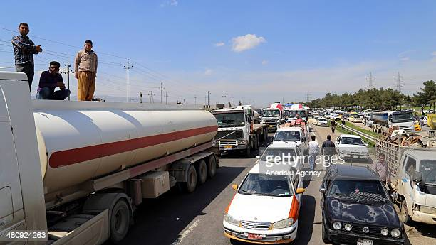 Iraqis gather to protest the pollution due to the oil refinery and cement plant around the city of Sulaymaniyah Iraq on March 27 2014 Activists set...