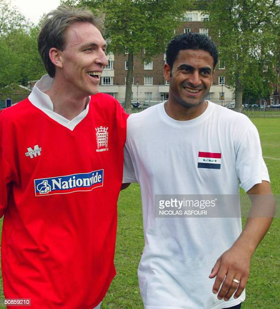Iraqi's Hassan Turke Atia is congratulated by Eastwood Labour MP Jim Murphy in London 20 May 2004 UK parliamentary football club pays against the...