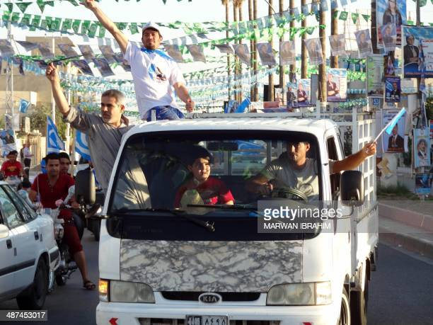 Iraqis in a vehicule voice their support for Iraqi Turkmen Front chairman Arshad alSalihi on the day of the general election on April 30 2014 in the...