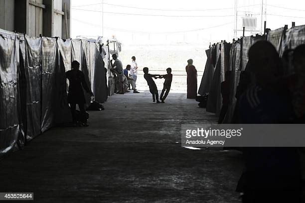 Iraqis including Turkmen Shabaks Kurds Yezidis and Christians fleeing from assaults of army groups led by Islamic State take shelter at Bahirka Camp...