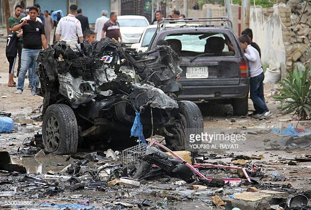 Iraqis inspect on May 10 2016 the site of a car bomb explosion which hit the Shifta area in the city of Baquba the previous day killing at least 10...