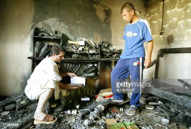 Iraqis inspect wreckage inside a house was hit by a mortar shell duing an overnight attack in the restive city of Baquba northeast of Baghdad 09 June...