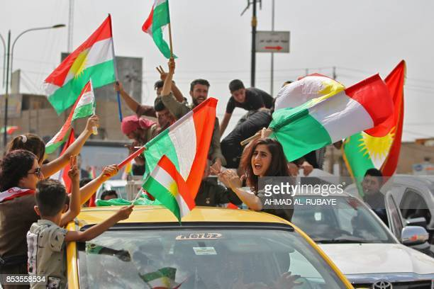 Iraqis Kurds celebrate with the Kurdish flag in the streets of the northern city of Kirkuk on September 25 2017 as they vote in a referendum on...