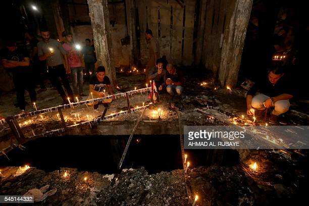 TOPSHOT Iraqis light candles on July 5 2016 at the site of a suicide car bomb attack which took place early on July 3 in Baghdad's Karrada...