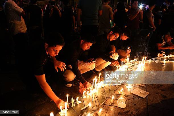 Iraqis light candles on July 8 2016 at the site of a bomb attack which killed 292 people in Baghdad's district of Karrada