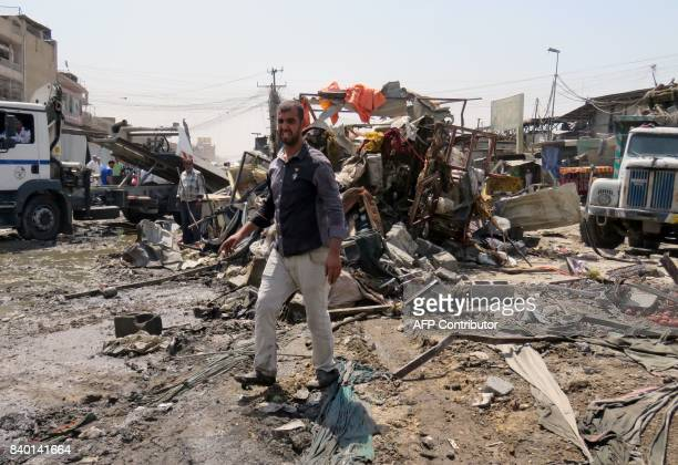 TOPSHOT Iraqis look at the damage following a car bomb explosion in Baghdad's Shiitemajority district of Sadr City on August 28 2017 Security sources...
