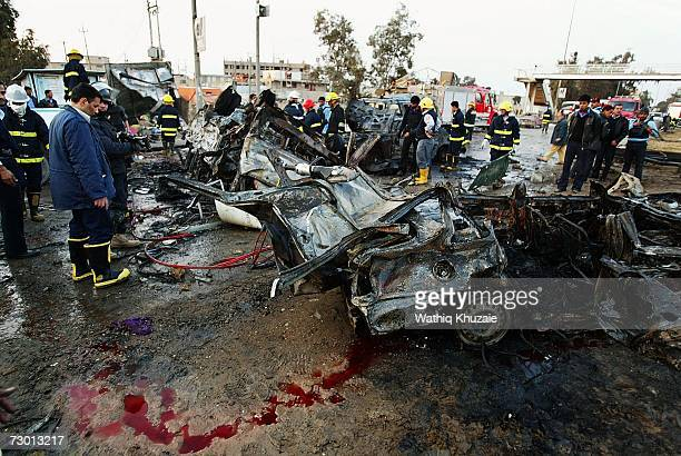 Iraqis look at the scene of two explosions in front of alMustansiriyah University on January 16 2007 in Baghdad Iraq A suicide bomber blew himself up...