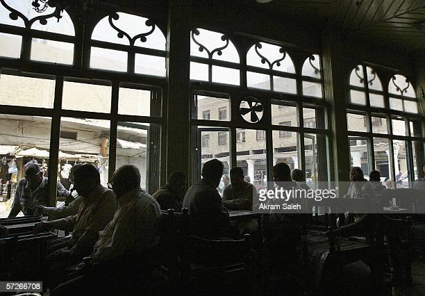 Iraqis play backgammon at a tea shop April 6 2006 in Baghdad Iraq According to the US Military Muhammed Hila Hammad Ubaydi a top aid to AlQaeda's top...