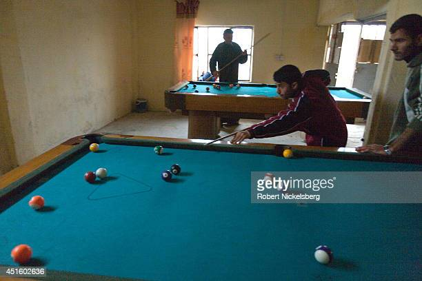 Iraqis play pool February 17, 2007 in a pool hall in Husayba, Iraq. Husayba, a strategic border crossing with Syria along the Euphrates River, was...