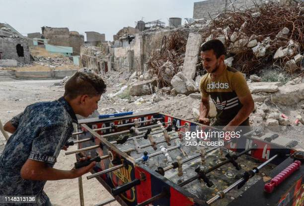 Iraqis play table football in the northern city of Mosul on June 6, 2019 as they celebrate Eid al-Fitr, the end of the holy fasting month of Ramadan.