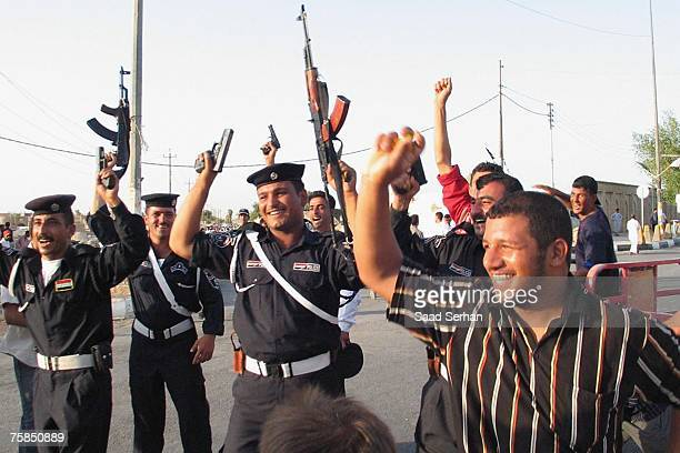 Iraqis policemen celebrate after their national team won the final game of the 2007 AFC Asian Cup soccer tournament against Saudi Arabia on July 29...