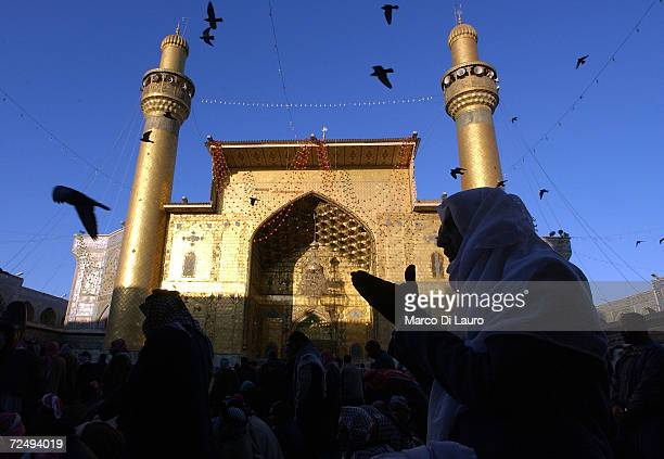 Iraqis pray at the shrine of Imam Ali at sunrise during a prayer held to celebrate Eid alAdha on February 2 2004 in Najaf 180 km south of Baghdad...