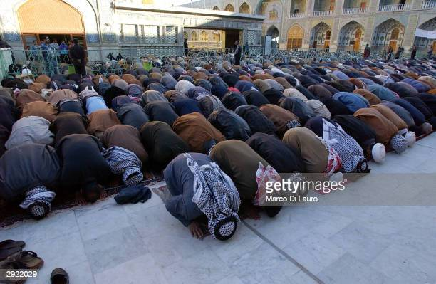 Iraqis pray at the shrine of Imam Ali during prayers held to celebrate Eid alAdha on February 2 2004 in Najaf 180 km south of Baghdad Iraqis from all...