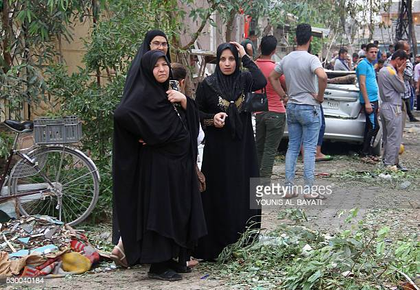 Iraqis react on May 10 2016 the site of a car bomb explosion which hit the Shifta area in the city of Baquba the previous day killing at least 10...