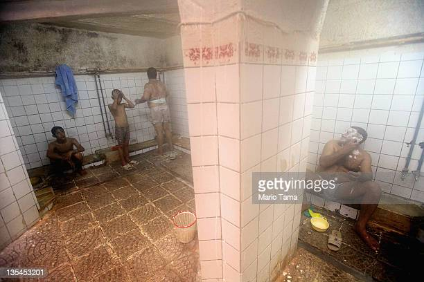 Iraqis relax in a hamam or Turkish bath on December 10 2011 in Baghdad Iraq Some Iraqis visit the baths because they do not have hot water at home...