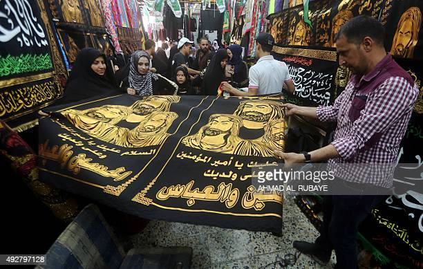 Iraqis shop for flags and banners bearing portraits of Imam Hussein grandson of Islam's Prophet Mohammed in a Baghdad Shiite suburb on October 15...