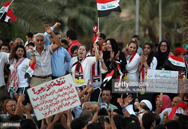 Iraqis shout slogans as they demonstrate against corruption in Baghdad's Tahrir Square on October 9 2015 Protesters have taken to the streets of the...