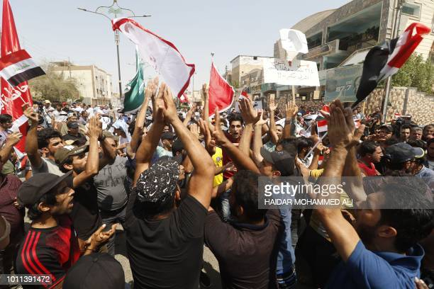Iraqis shout slogans during ongoing protests in the southern city of Basra on August 5, 2018. - Iraq has been gripped by protests over power outages,...