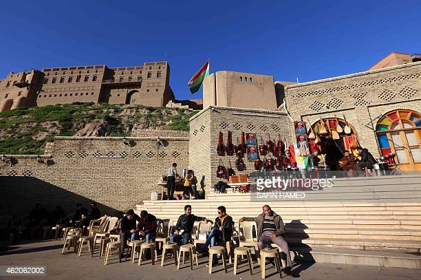 Iraqis sit outside a market located at the bottom of the Arbil Citadel on January 13 2015 in Arbil the capital of the autonomous Kurdish region of...