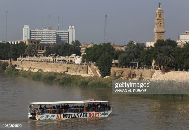 Iraqis take a ride in a ferry across the Tigris River in central Baghdad on Friday the frist day of the local weekend on November 16 2018 Iraqi...
