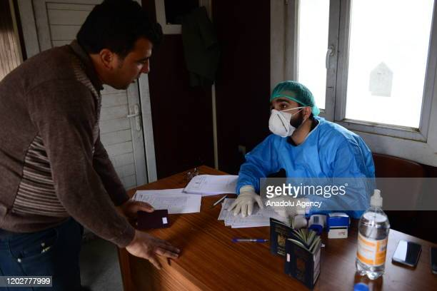 Iraqis take medical precautions at the Bashmaq border crossing with Iran to prevent the spread of coronavirus officially known as COVID19 in...