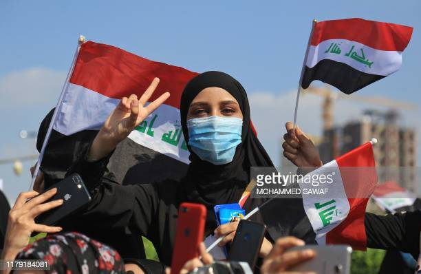 Iraqis take part in ongoing anti-government protests in the central city of Karabala on October 31, 2019. - Iraq's leaders scrambled to produce a...