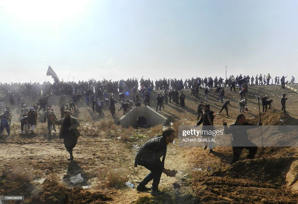 Iraqis throw stones after protesters attacked Iraq's deputy premier Saleh al-Mutlak on December 30, 2012, forcing him to flee a rally he was addressing on the outskirts of the western city of Ramadi, an AFP reporter said. The demonstrators, who have blocked a key highway connecting Iraq to Syria and Jordan for the past week over the alleged targeting of their Sunni Arab minority by the Shiite-led government in Baghdad, threw water bottles, stones and shoes at Mutlak before grabbing and hitting him.