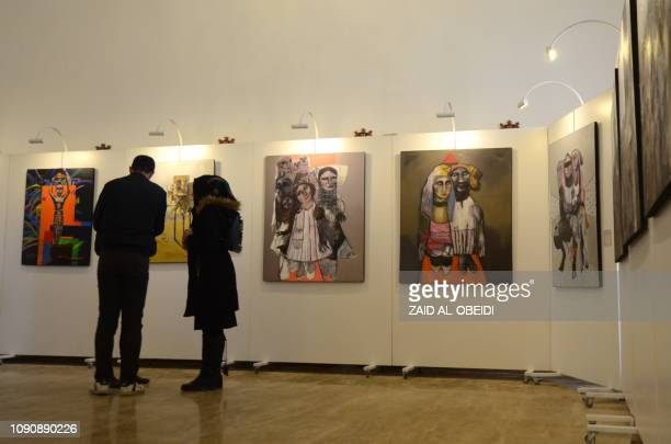 Iraqis tour on January 29 2019 a contemporary art exhibition at one of the halls of the national museum of the northern Iraqi city of Mosul which...