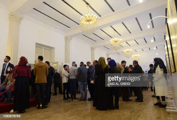 Iraqis tour on January 29 2019 an exhibition held at the museum of the northern Iraqi city of Mosul which served as the Islamic State group's brutal...