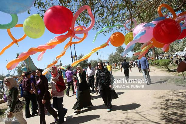 Iraqis visit a theme park as they celebrate Noruz in central Baghdad on March 21 2010 Noruz is an ancient Persian festival celebrated on the first...