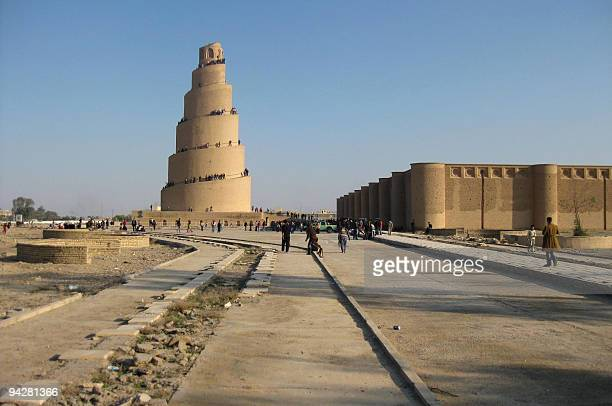Iraqis visit Malwiya minaret, a mid-ninth century structure in the restive city of Samarra, north of Baghdad, upon its official re-opening to...